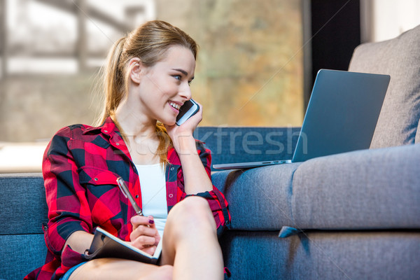 Girl talking on smartphone Stock photo © LightFieldStudios