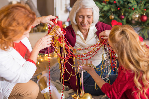 Family having fun with christmas decorations Stock photo © LightFieldStudios