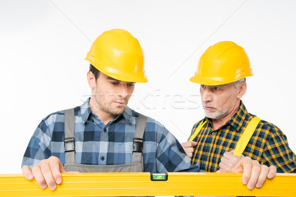 Stock photo: Workmen with level tool