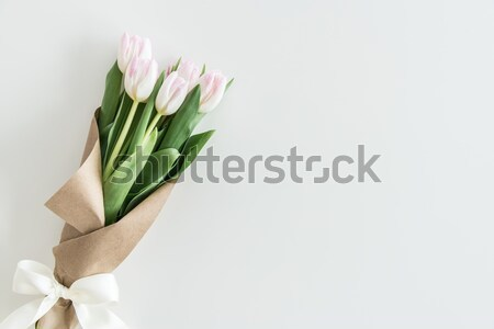 light pink tulips bouquet in kraft paper isolated on white, wedding flowers bouquet concept Stock photo © LightFieldStudios
