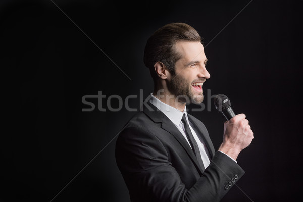 Young man with microphone Stock photo © LightFieldStudios