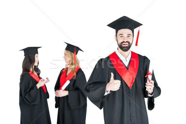 Boldog fiatalember tudományos sapka tart diploma Stock fotó © LightFieldStudios