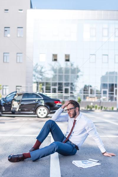 stressed businessman sitting on parking Stock photo © LightFieldStudios
