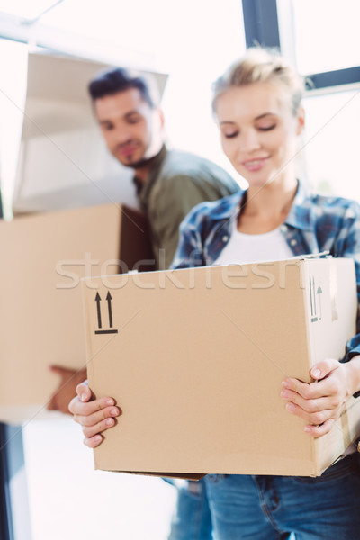 couple with cardboard boxes in new house Stock photo © LightFieldStudios