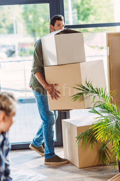 man holding cardboard boxes Stock photo © LightFieldStudios