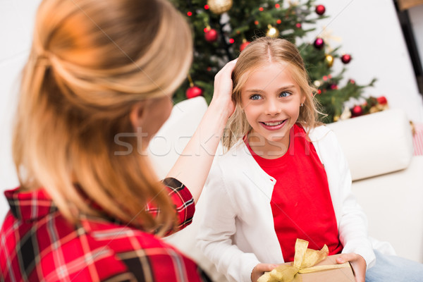 Stock photo: mother and daughter with christmas present