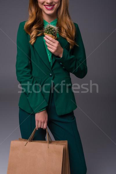 Lány kaktusz bevásárlótáskák kilátás elegáns zöld Stock fotó © LightFieldStudios