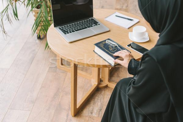 muslim woman with quran book Stock photo © LightFieldStudios