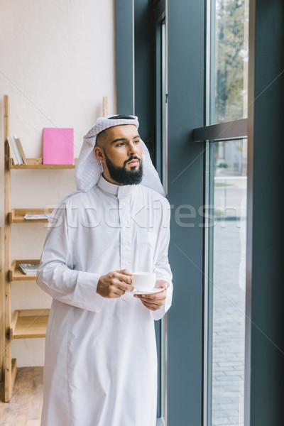 Muçulmano homem copo café bonito escritório Foto stock © LightFieldStudios