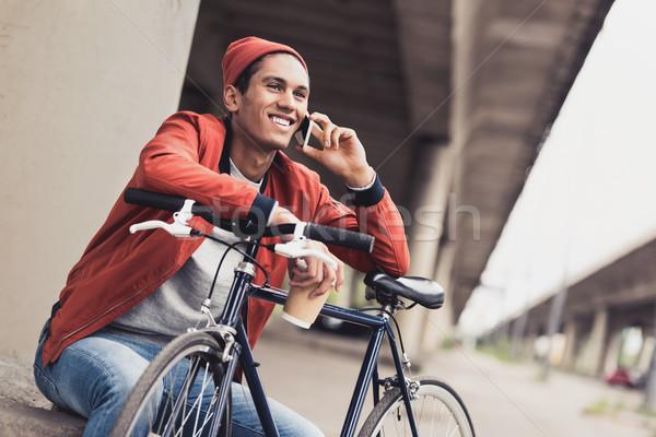 Man fiets praten telefoon glimlachend jonge man Stockfoto © LightFieldStudios