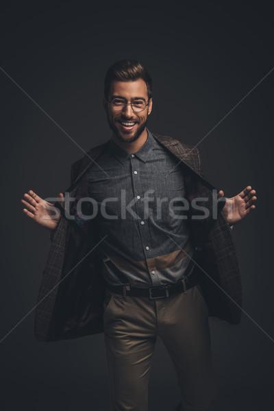 man pulling suspenders Stock photo © LightFieldStudios