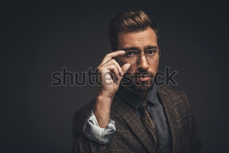 man adjusting glasses Stock photo © LightFieldStudios