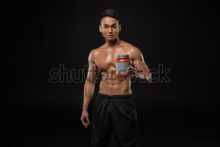 Stock photo: muscular man with sport nutrition