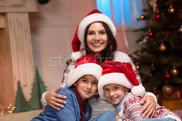 mother with kids in santa hats Stock photo © LightFieldStudios