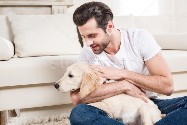 Man petting puppy Stock photo © LightFieldStudios