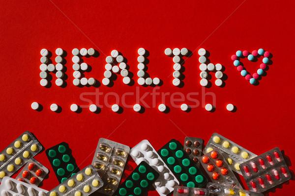Stockfoto: Geneeskunde · pillen · woord · gezondheid