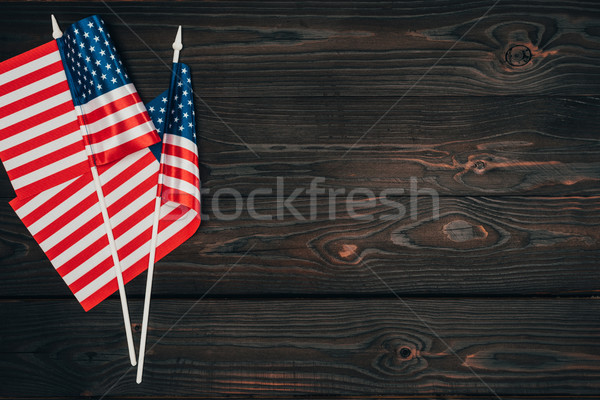 top view of arranged american flags on dark wooden surface, presidents day celebration concept Stock photo © LightFieldStudios