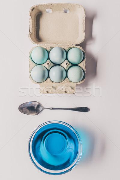 Superior vista vidrio azul pintura cuchara Foto stock © LightFieldStudios