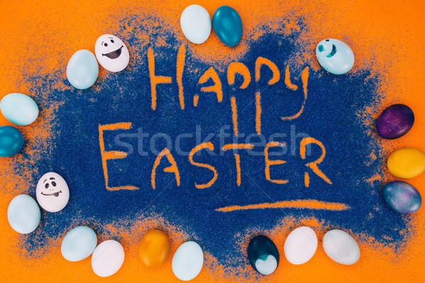 Felső kilátás kellemes húsvétot felirat kék homok Stock fotó © LightFieldStudios
