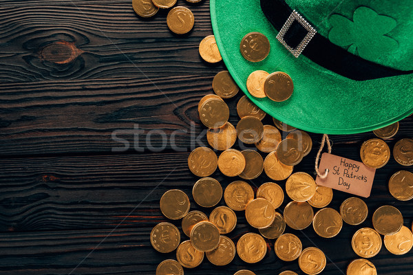 top view of green hat and golden coins, st patricks day concept Stock photo © LightFieldStudios
