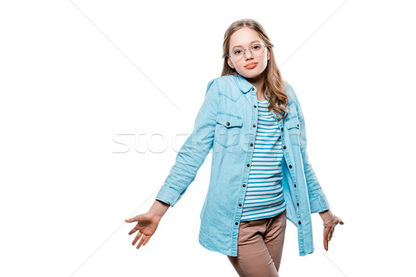 uncertain teenage girl in eyeglasses looking at camera isolated on white Stock photo © LightFieldStudios