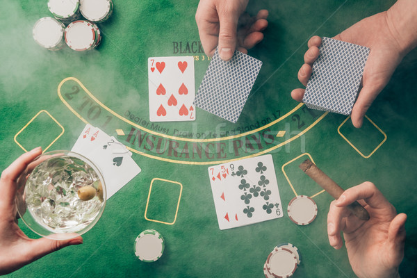 Smoke over people playing black jack by casino table with cards and chips Stock photo © LightFieldStudios
