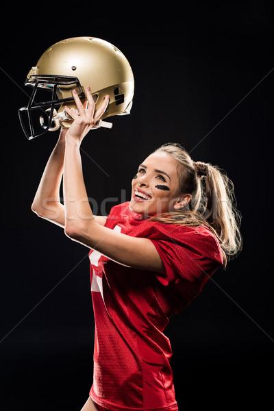 Női futballista éljenez sisak mosolyog amerikai Stock fotó © LightFieldStudios