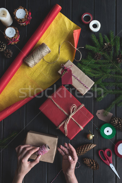woman decorating christmas gifts Stock photo © LightFieldStudios