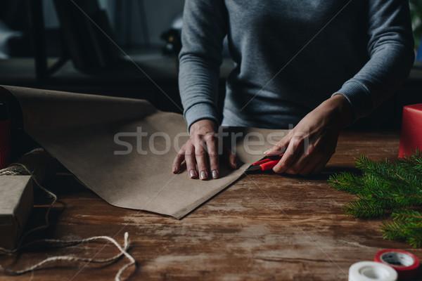 woman cutting kraft paper Stock photo © LightFieldStudios