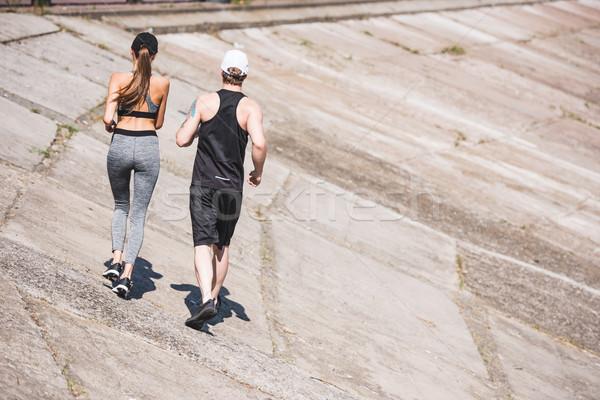 Stock photo: couple jogging on slabs