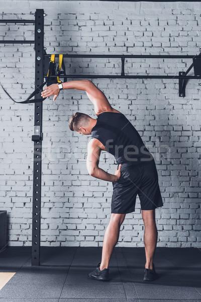 Man opleiding achteraanzicht jonge man sportkleding Stockfoto © LightFieldStudios