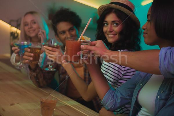Multiculturele vrienden partij selectieve aandacht cocktails samen Stockfoto © LightFieldStudios
