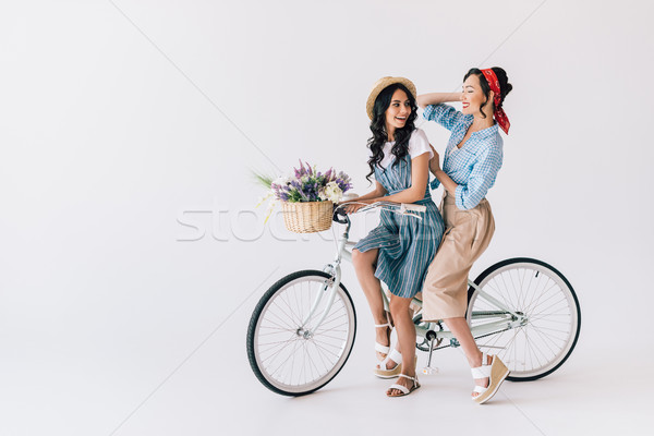 multicultural women on bicycle Stock photo © LightFieldStudios