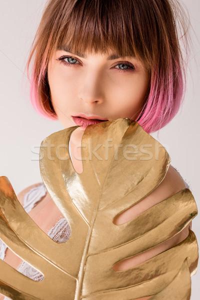 Vrouw poseren gouden palmblad portret jonge vrouw Stockfoto © LightFieldStudios