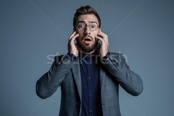 страшно человека костюм молодым человеком формальный очки Сток-фото © LightFieldStudios