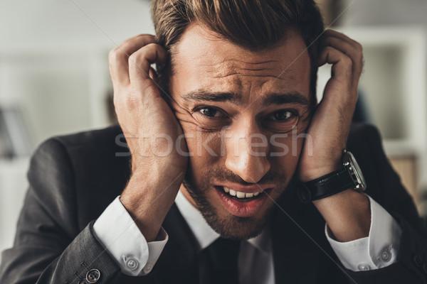 Bunalımlı işadamı kafa genç eller Stok fotoğraf © LightFieldStudios