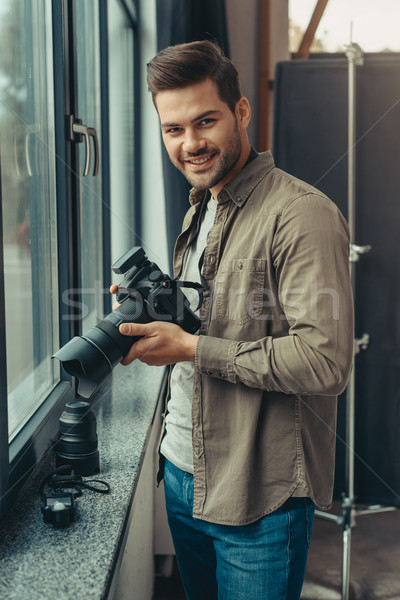 photographer with digital camera Stock photo © LightFieldStudios