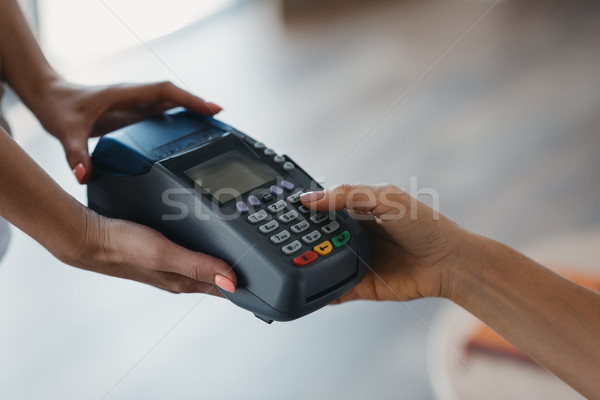 Stock photo: Payment with credit card and terminal