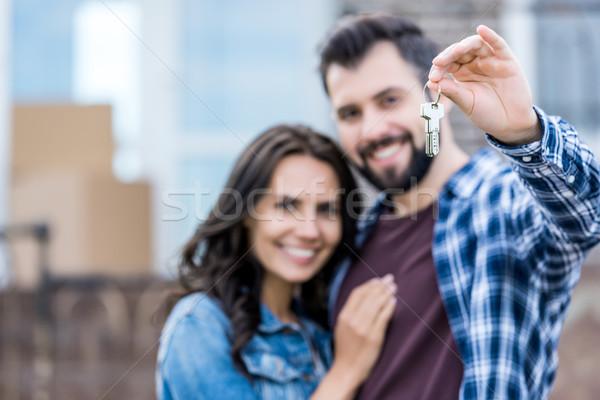 couple with keys of new house Stock photo © LightFieldStudios