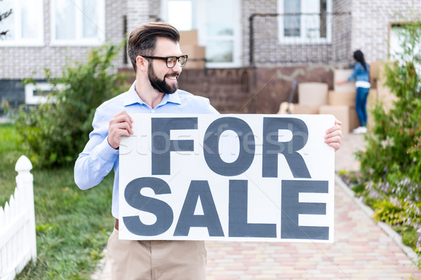 realtor with banner for sale Stock photo © LightFieldStudios
