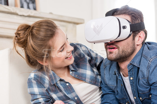 Couple using virtual reality headset Stock photo © LightFieldStudios