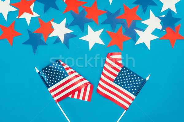 top view of arranged stars and american flags isolated on blue, presidents day celebration concept Stock photo © LightFieldStudios