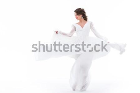elegant bride dancing in traditional white dress, isolated on white Stock photo © LightFieldStudios