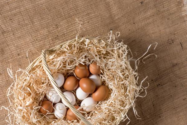 Chicken eggs in basket Stock photo © LightFieldStudios