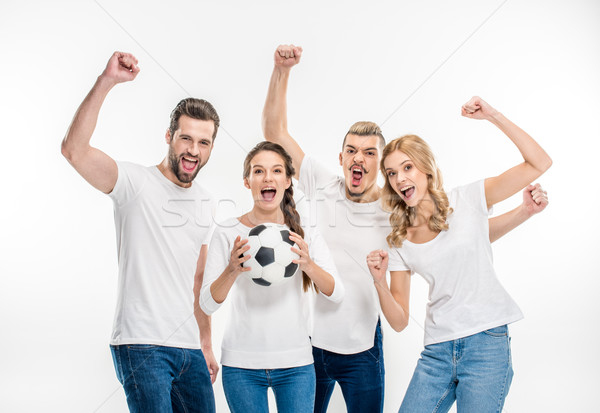 Stock photo: Cheerful friends with soccer ball