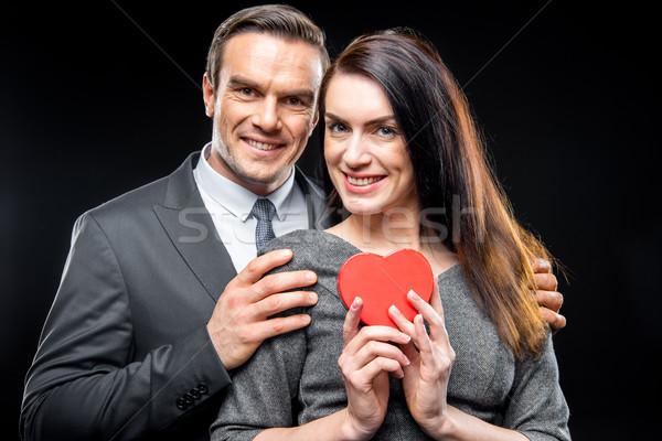 Couple holding toy heart Stock photo © LightFieldStudios