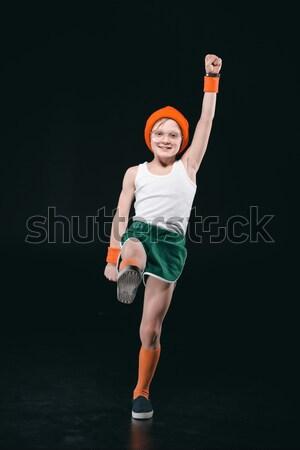 Mosolyog sportos lány ugrik izolált fekete Stock fotó © LightFieldStudios