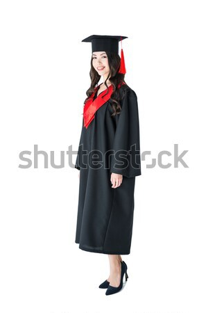 Full length view of beautiful young brunette woman in academic gown and mortarboard Stock photo © LightFieldStudios