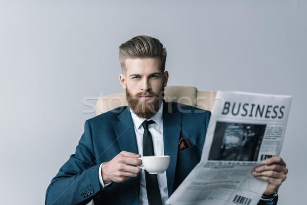 Portret zakenman beker koffie krant Stockfoto © LightFieldStudios