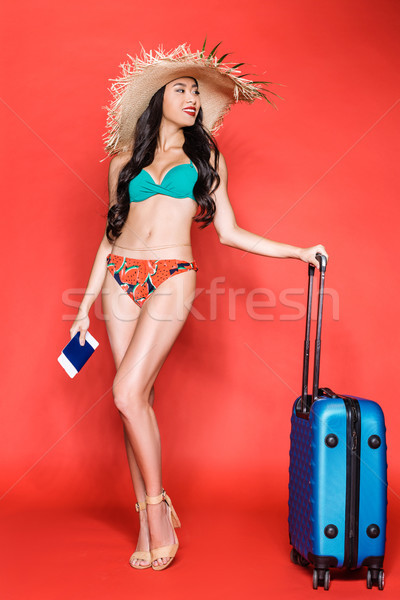 Stock photo: woman in swimsuit with suitcase and tickets